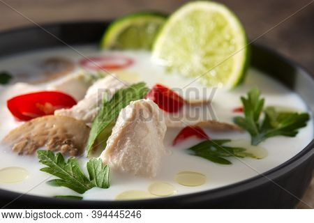 Traditional Thai Food Tom Kha Gai In Bowl On Wooden Table.close Up