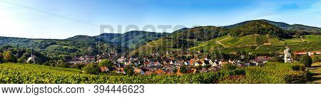Panoramic View Of The Stunning Village Of Andlau In Alsace. Slopes With Ripening Grapes. Great Views