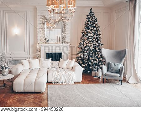 Decorated Christmas Tree With Gifts In White Classic Living Room Interior With New Years Holiday Spa