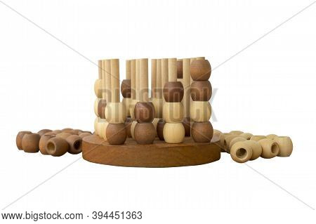 Board Game With Wooden Balls. An Exciting Puzzle Game With Barrels. Tic-tac-toe In Three Dimensions,