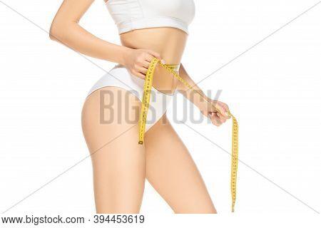 Tape Measure. Close Up Beautiful Female Model On White Background. Beauty, Cosmetics, Spa, Depilatio