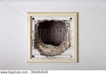 Dusty Air Vent In The Wall With The Protective Grate Removed For Inspection And Cleaning