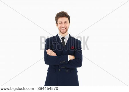 Handsome Businessman In A Suit And Tie Is Folding One's Arm Over The Chest And Smiling With Their Ar