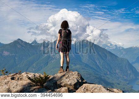 Adventurous Girl Hiking On Top Of Tin Hat Mountain, Part Of The Popular Sunshine Coast Hiking Trail