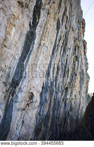 A Strong Girl Climbs A Rock, Rock Climbing In Turkey, Training Endurance And Strength, Woman In Extr