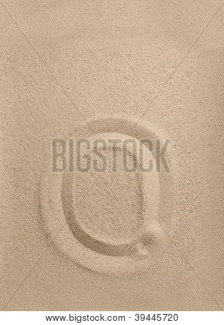 Letter o from sand