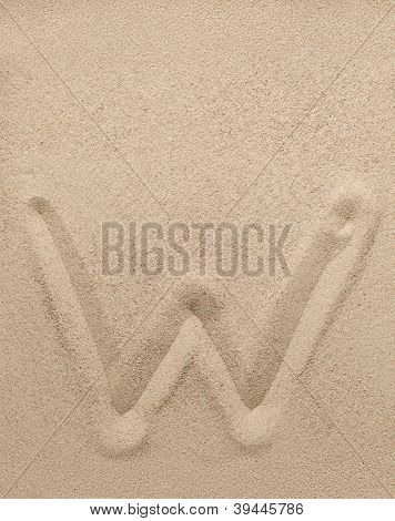 Letter w from sand
