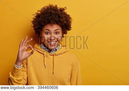 Not Bad. Glad Hipster Girl Shows Okay Gesture, Approval Sign, Accepts Good Idea, Smiles Positively,