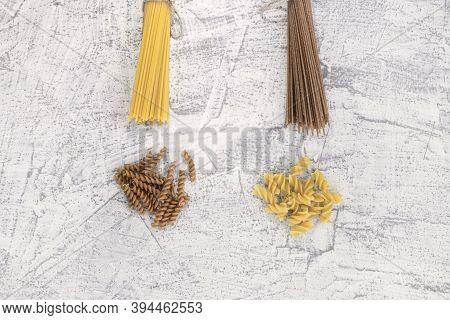 Bran Pasta. Various Pasta On A White Stone Background. Top View