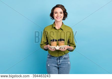 Photo Portrait Of Woman Holding Two Cups Of Coffee In Cardboard Holder Isolated On Pastel Light Blue