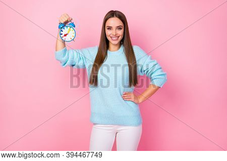 Photo Of Attractive Self-confident Lady Hold Colorful Design Alarm Clock Punctual Worker Never Late