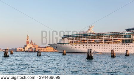 Big Cruise Ship With Tourists Leaving The City Of Venice Italy In The Evening
