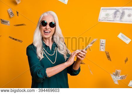 Photo Of Funky Grandma Lady Hold Pack Usa Bucks Money Fall From Sky Wealthy Waste Money Rich Person