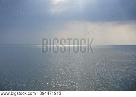 Sun Light Rays With Bright Sky And Clouds Over The Sea. Horizon  Skyline Nice Weather Nature Backgro
