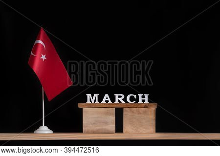 Wooden Calendar Of March With Turkish Flag On Black Background. Holidays Of Turkey In March.