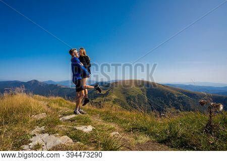 Happy Couple Trekking In Autumn Woods, Photo Taken In Slovakian Velka Fatra Mountains, Path Through