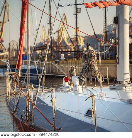 Sail Yacht Standing Moored In The Sea Port, Sailboat Harbor. Forward, Sail And Nautical Ropes Yacht