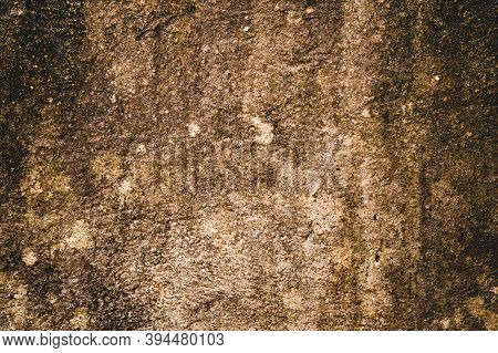 Moist Damp Patch On Sand Wall Due To Rain Penetration. Grunge Crack Moist Concrete Sand Wall Texture