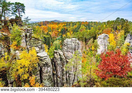 Prachov Rocks, Czech: Prachovske Skaly, With Colorful Trees Of Autumn. Sandstone Rock Formation In B