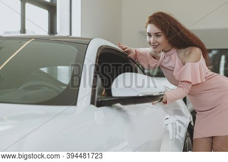Attractive Female Driver Looking Inside A New Sportscar, Shopping For Automobile. Gorgeous Woman Exa