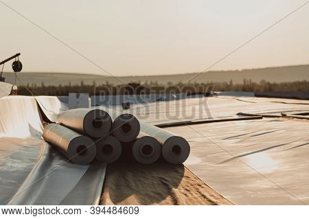 Roofing Pvc Membrane In Rolls Placed On The Roof Of A Hall.rubber Membrane Ready.