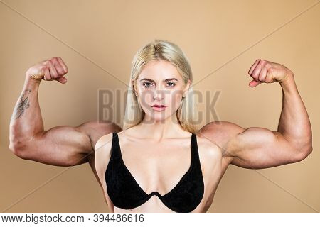 Female Model Keeps Fit And Healthy, Raises Hands And Shows Muscles, Power. Strong Muscle Arms. Funny