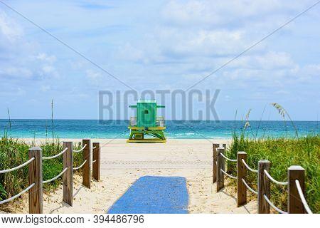 Sunny Day In Miami Beach. Miami Beach, Florida, Usa Sunrise And Life Guard Tower