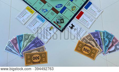 Pieces For The Game Monopoly By Hasbro On A White Background.  Concept Business.