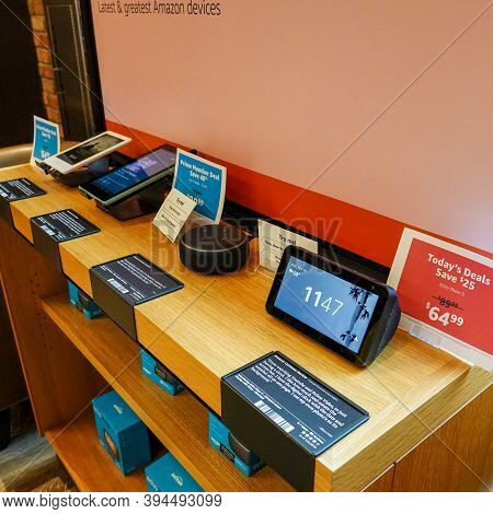 An Amazon Kindle Paperwhite, Fire, Alexa Echo Dot, And Echo Show 5 For Sale An Amazon Bookstore.