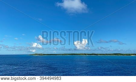 The Private Island Of Half Moon Cay In The Bahamas On A Sunny Day With Blue Skies.