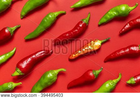 Hot Red And Green Fresh Chili Peppers On Red Background Flat Lay Top View. Seasoning For Dish,  For