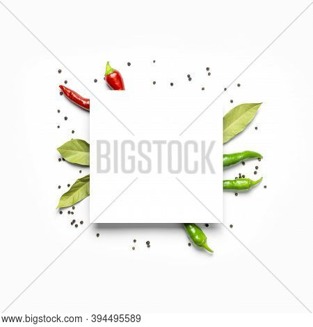 Creative Food Layout. Hot Red And Green Fresh Chili Peppers Bay Leaf Dry Black Peppercorns, White Bl