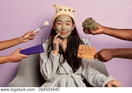 Young Beautiful Asian Woman Wears Moisturizing Face Mask, Dressed In Comfortable Domestic Clothes, U