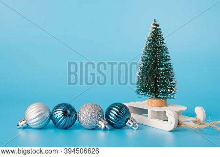 Close Up Photo Of Mini Christmas Tree Standing On Little White Wooden Sledge With Small Baubles Besi