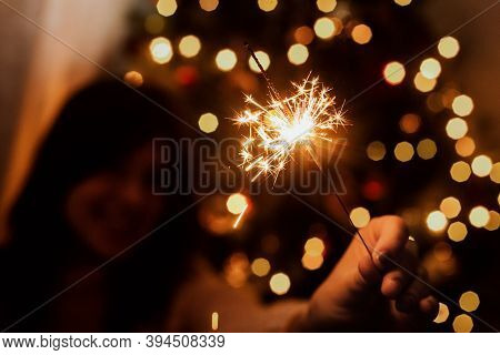Young Female Celebrating New Year With Firework. Happy New Year!