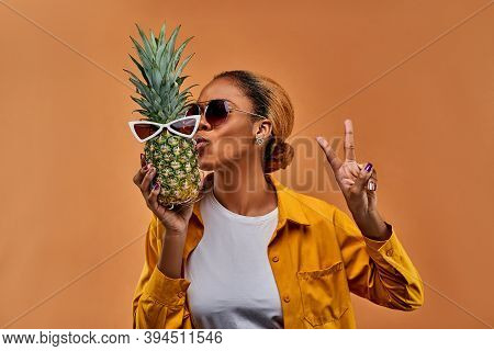 Happy Lady With Sunglasses With A Pineapple In White Sunglasses And Shows A Symbol Of Peace - Two Fi