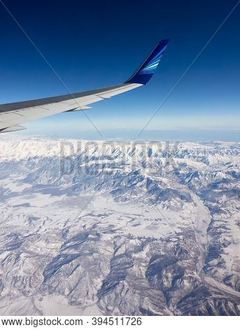Caucasus Range, Azerbaijan - February 12, 2020: Azerbaijan Airlines Passenger Airliner Wing With Com