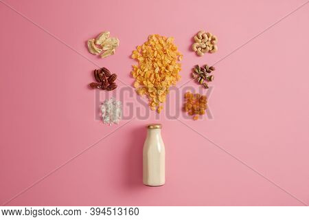 Set Of Cereals, Pistachio, Raisins, Pecan Nuts, Dried Apple, Cashew, Coconut Around Bottle Of Milk I