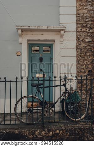 Frome, Uk - October 07, 2020: Bike Parked Outside A Traditional Stone House In Frome, A Market Town