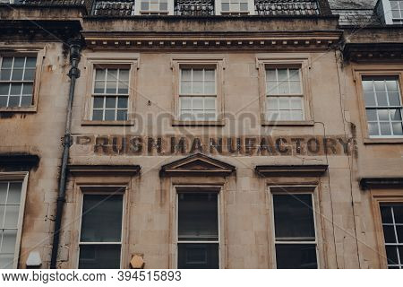 Bath, Uk - October 04, 2020: Brush Manufactory Sign On An Old Limestone House On A Street In Bath, T