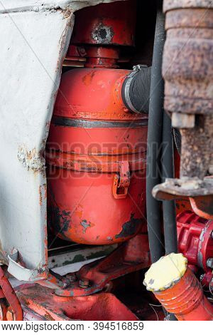 Closeup Of Coolant Reservoir In Old Vibrant Red Rusty Russian Tractor Engine On Sunny Autumn Day Sha