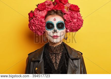 Traditional Holiday In November. Female With Sugar Skull Drawn With Smile, Wears Flower Wreath, Dres
