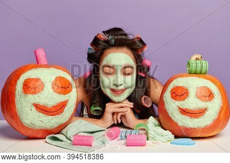 Beauty Treatments And Wellness Concept. Close Up Shot Of Relaxed Lovely Woman Leans At Table, Wears