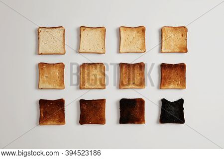 Pieces Of Bread Browned As Result Of Toasting. Delicious Crust Tender Slices Of Bread Prepared In To