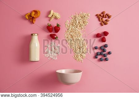 Oatmeal Cereals, Appetizing Fresh Berries, Dried Fruits, Vegetable Milk, Nuts And Bowl To Prepare Ta