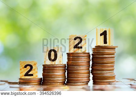 2021 And Coins Stack. Pension Fund, 401k, Passive Income. Investment And Retirement. Business Invest