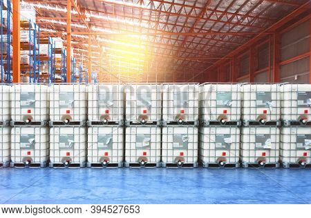Liquid Storage Tank Stack Inside Distribution Warehouse. Industrial Warehousing And Logistics. Stora