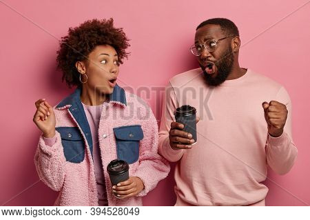 Image Of Amused Carefree Black Young Woman And Man Dance Happily, Drink Takeaway Coffee, Express Pos