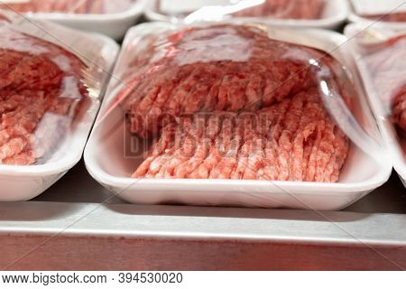 Raw Minced Meat On The Shelves Of A Hypermarket Close-up. Sale Of Fresh Meat