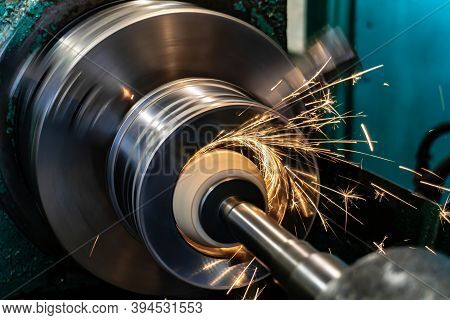 Grinding A Metal Inner Hole On A Circular Grinding Machine With Sparks In The Metalworking Industry